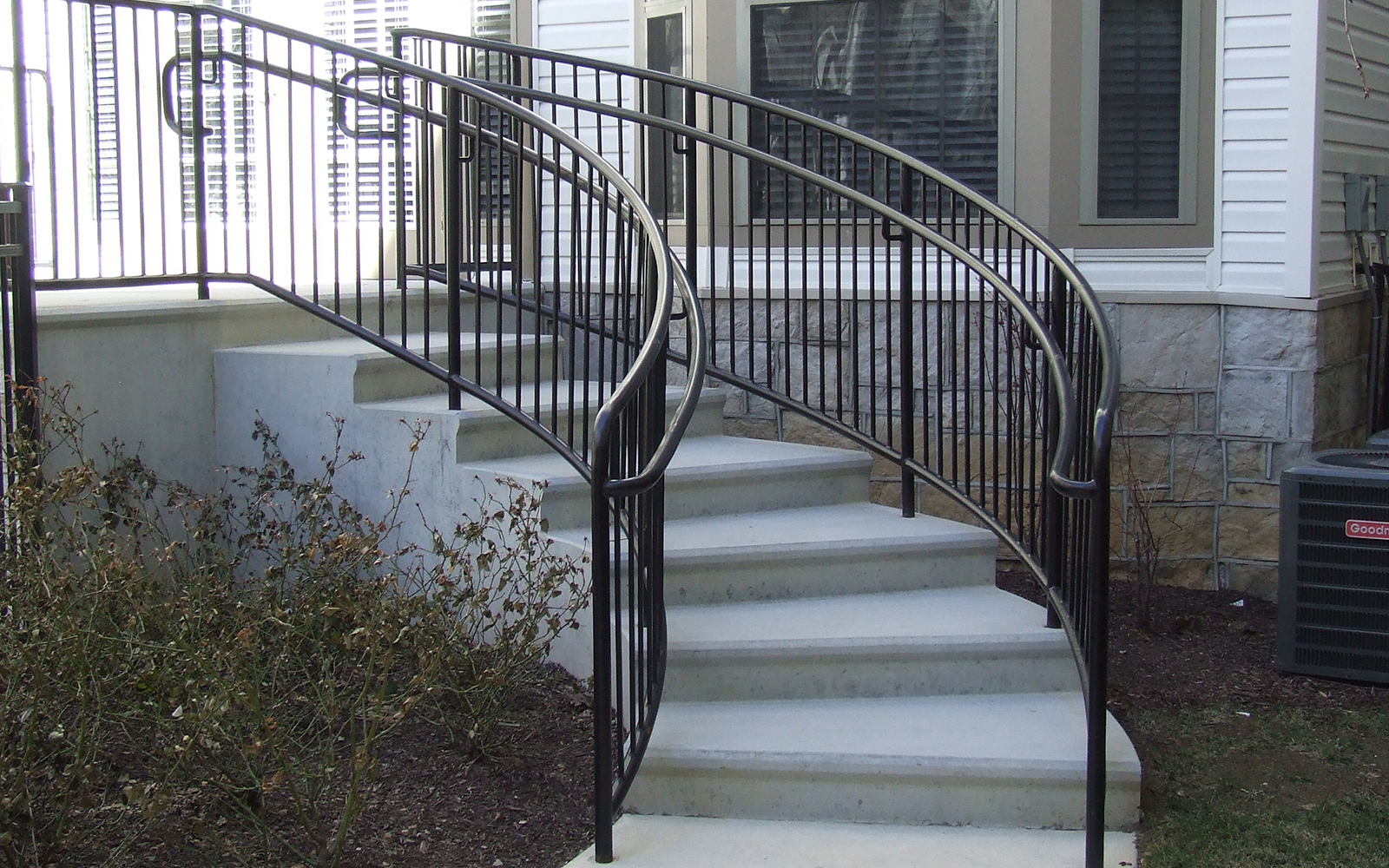 curved-steps-with-curved-railing