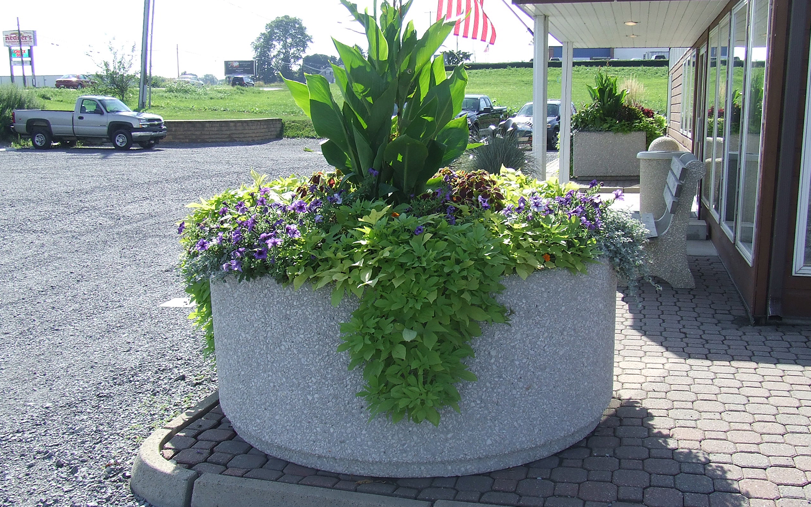 redi-guard-round-planter-with-plants