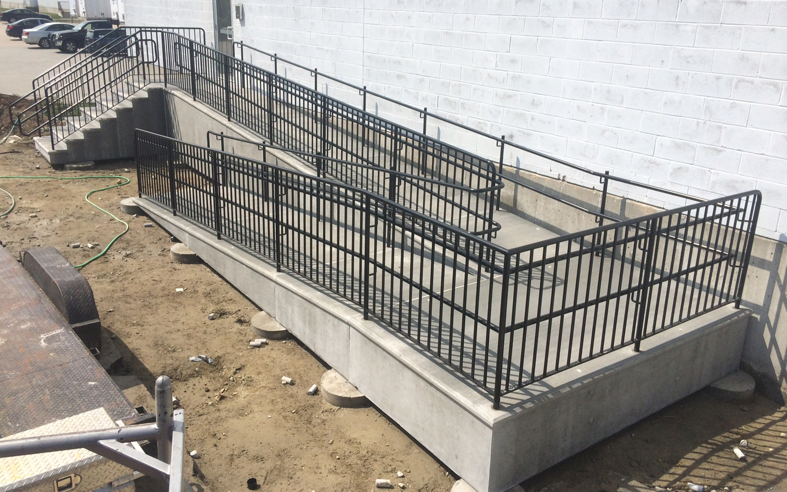concrete-access-ramp-with-steps-and-railing