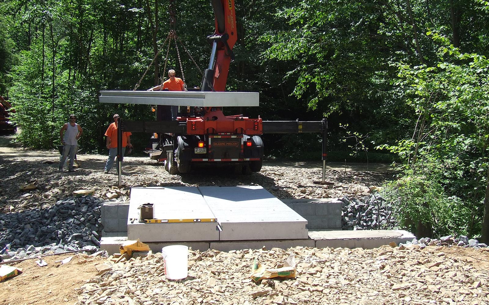custom-concrete-bridge-in-woods